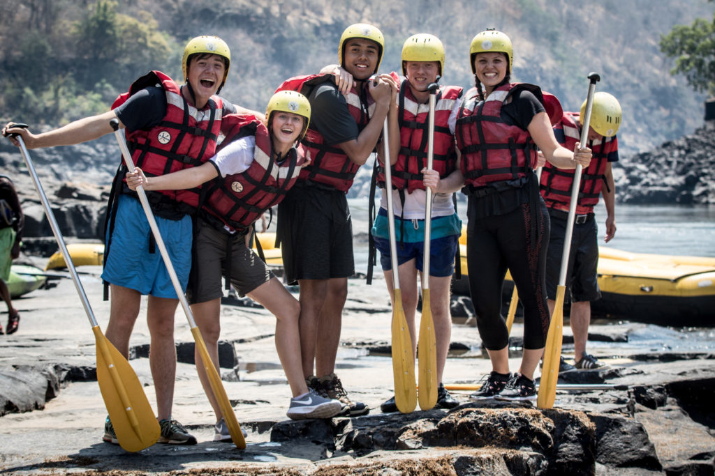 Young white water rafting team on the Zambezi below Victoria Falls.