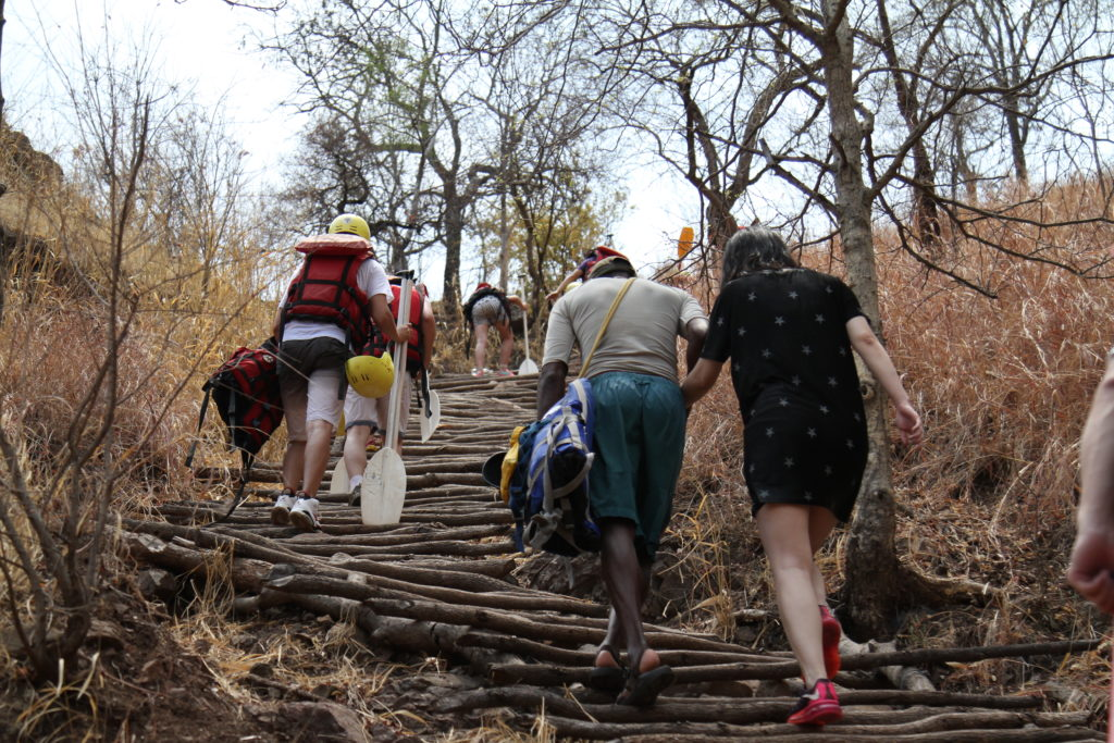 Guests hiking out of the gorge after Rafting the Zambezi River, Victoria Falls Zambia.