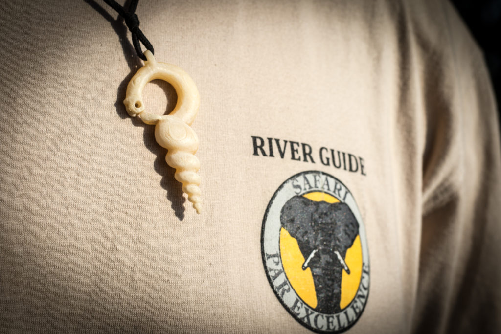 Nyami-nyami necklace, the god of the Zambezi River, Victoria Falls, Zambia.