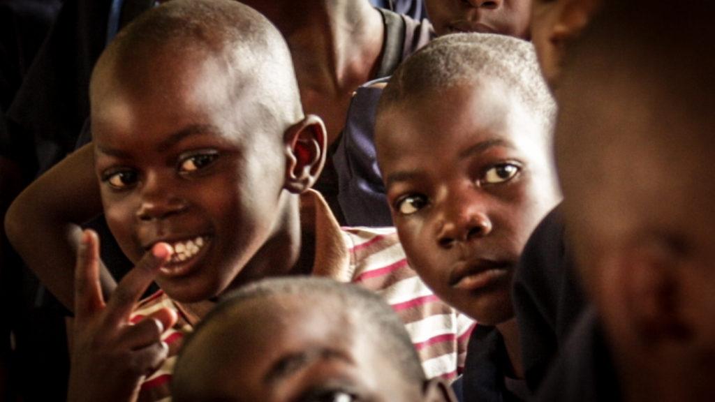 Zambian children getting shoes